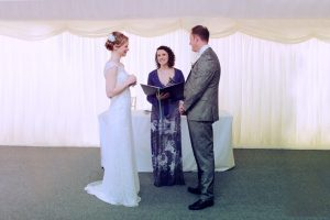 a bride and groom say their vows