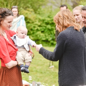 a baby is greeted by a famil member during a Naming Ceremony by Keli Tomlin Ceremonies