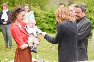 a baby is greeted by family