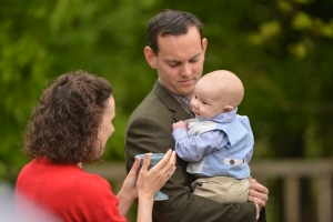 baby is blessed by celebrant