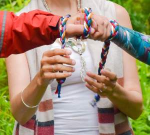 two hands tied with ribbons