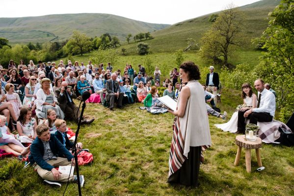 Guests assembled in Edale as Celebrant Keli Tomlin officiates over an outdoor wedding ceremony